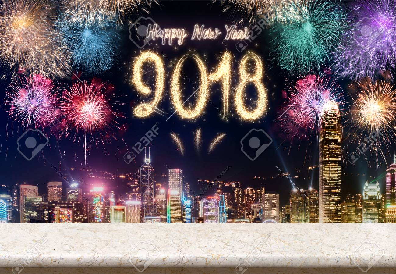 happy new year 2018 fireworks over cityscape at night with empty marble table topmock