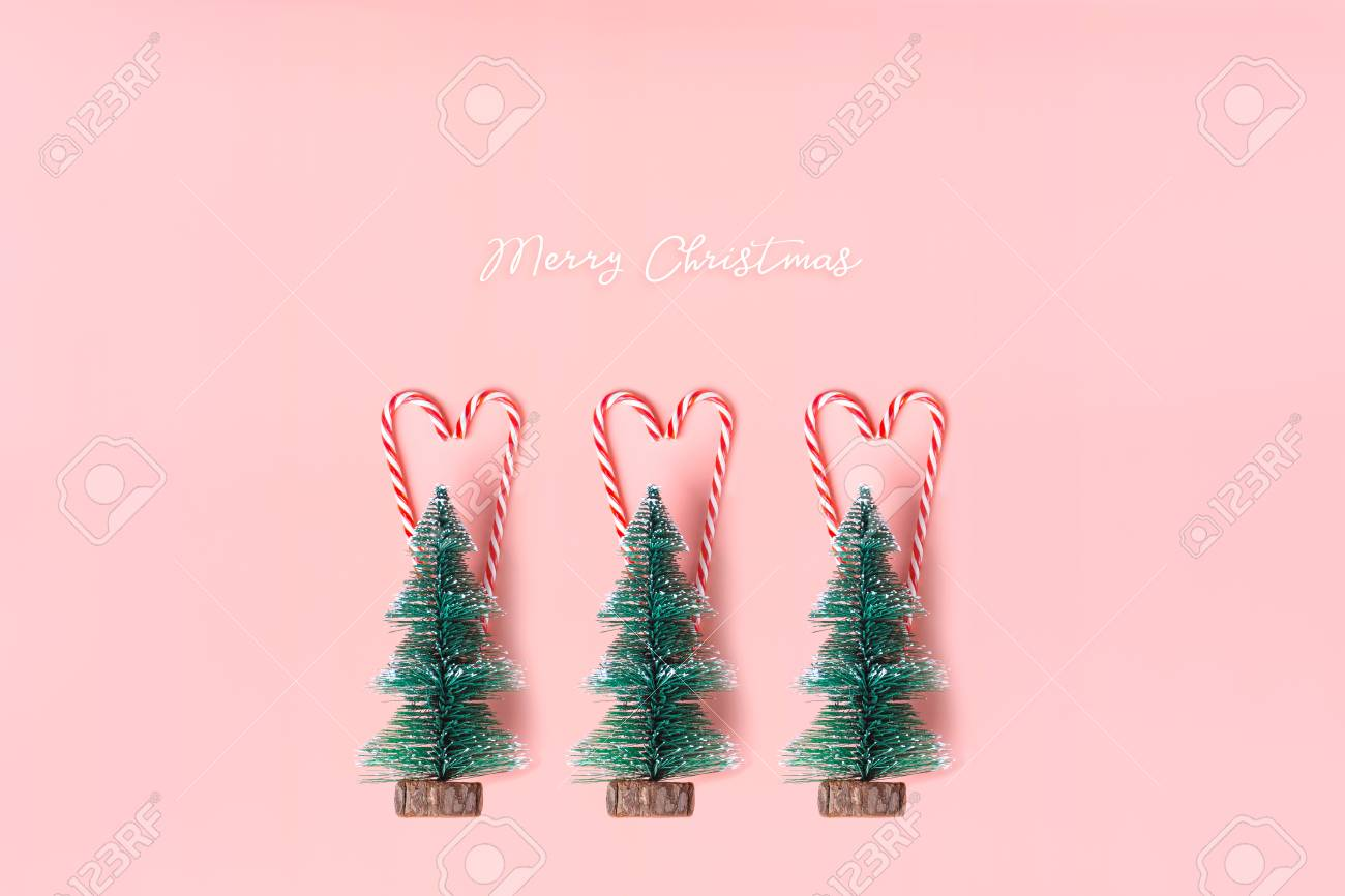 Tree Christmas Tree With Candy Cane Hanging On Pastel Pink Wall Stock Photo Picture And Royalty Free Image Image 103227916