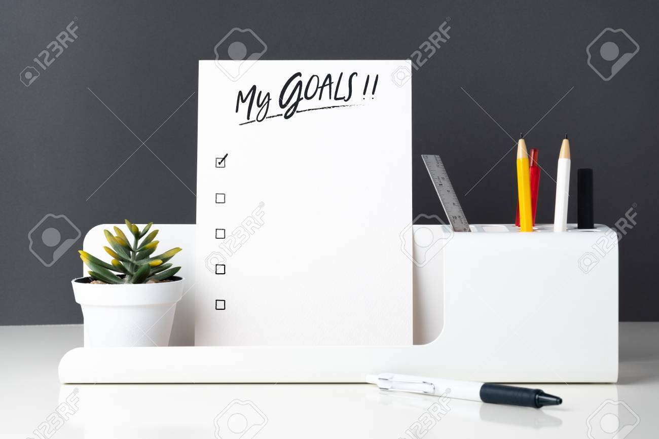 My goals list on notepad at modern office stationery on white