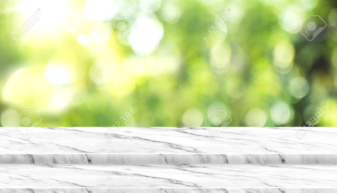 Empty white marble table top with blur tree in park with bokeh light at background,Mock up template for display of your design,Banner for advertise of product,panorama view. - 116064946