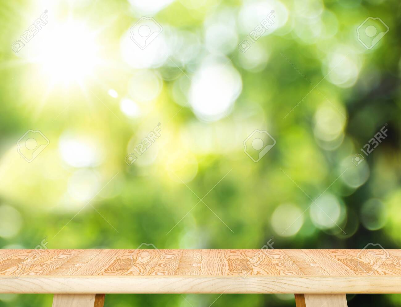 Empty wood plank table top with blur tree in park with bokeh light at background,Mock up template for display of your design,Banner for advertise of product - 143566131