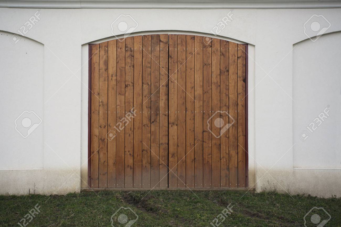 Big Wooden Barn Gate. Monumental Farm Door, Two Timber Leaf, Brown Gateway  Closed