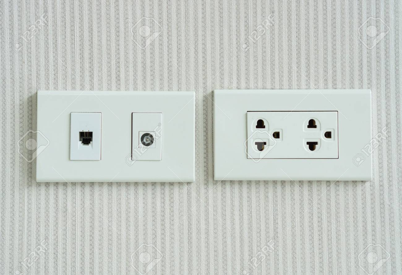 Electricity Socket And Telephone Socket Install On The Wall Stock ...