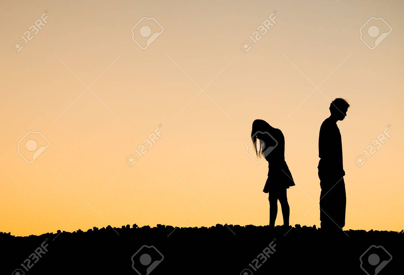 Silhouette of a angry woman and man on each other.Relationship difficulties - 50907130