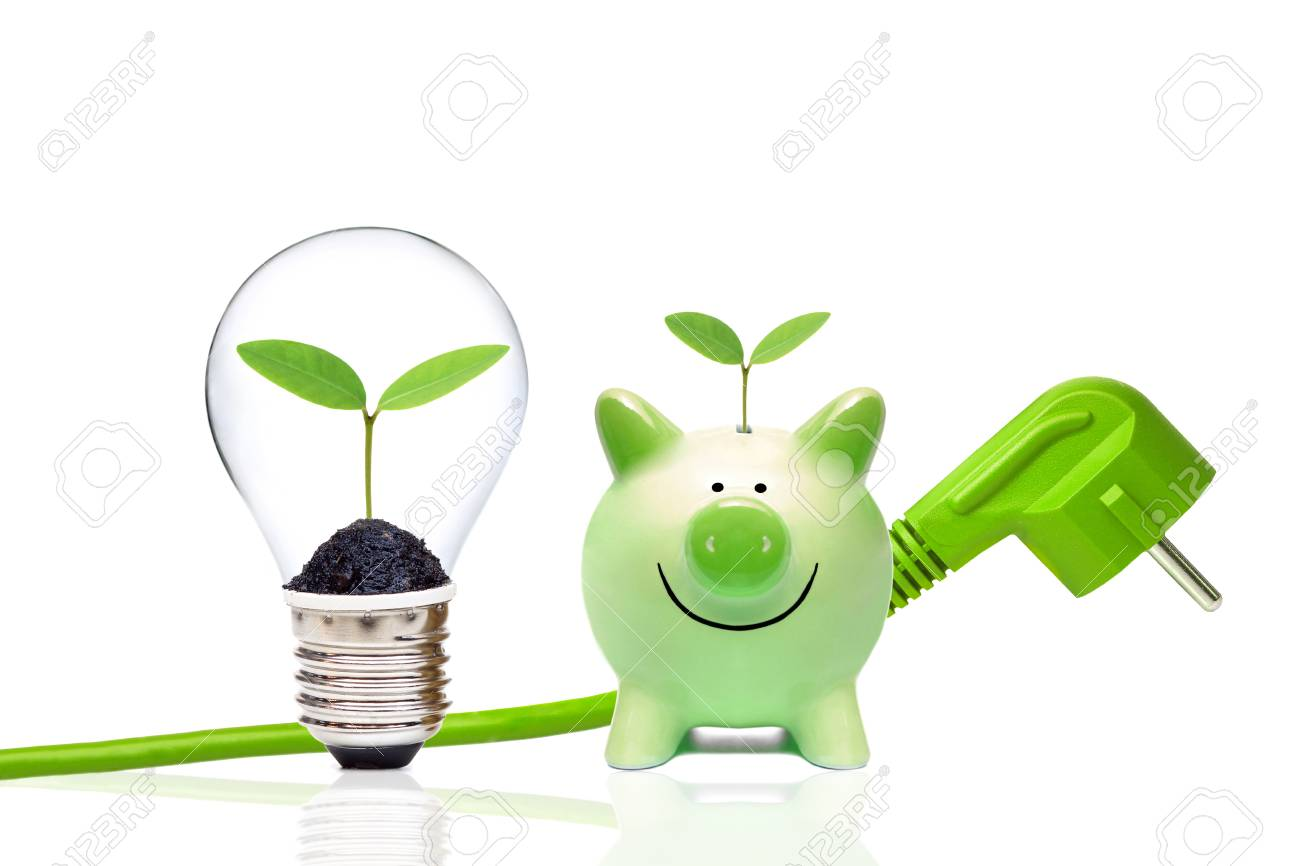 A green plug with green piggy bank and a light bulb with small green plants / Green energy and saving environment concept - 88968547