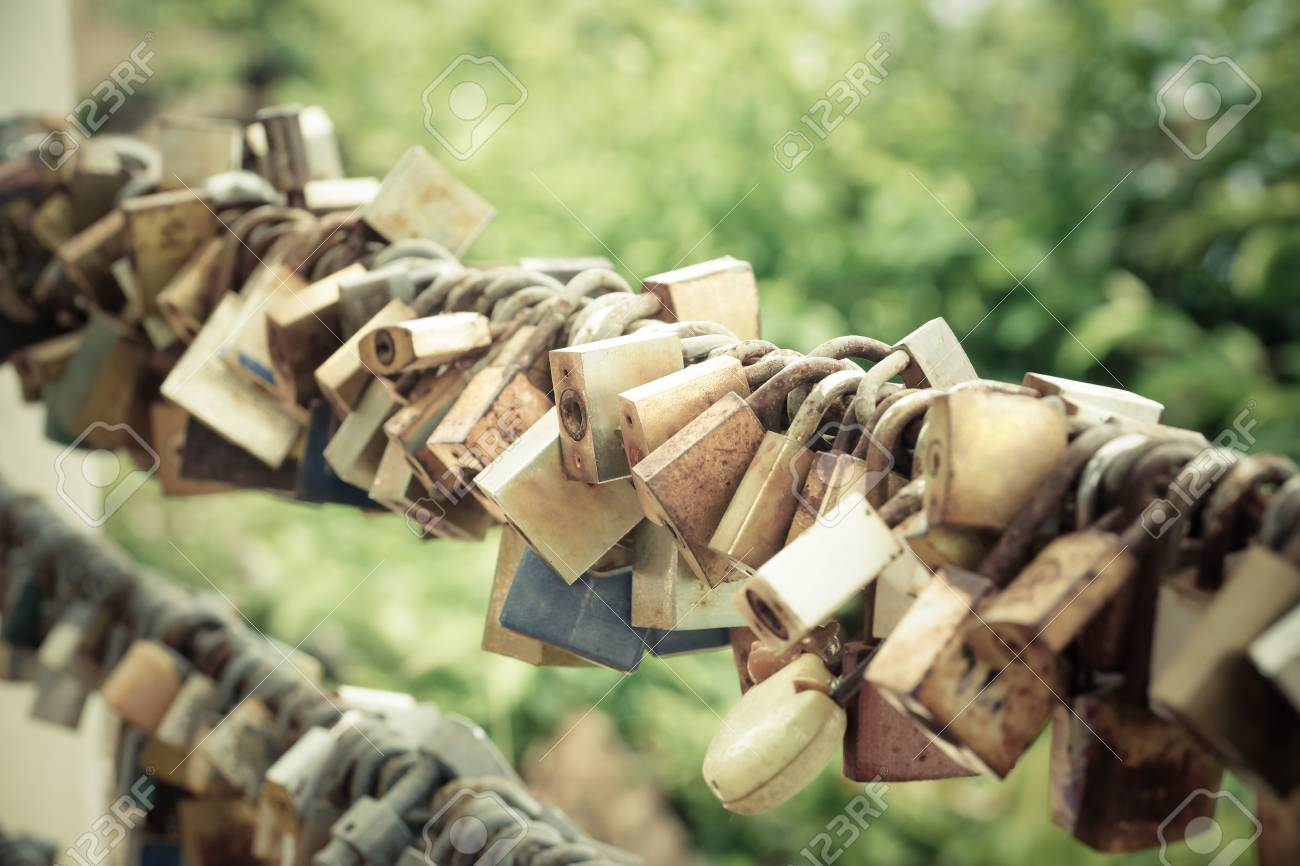 old locks hung on metal wire representing long lasting love of