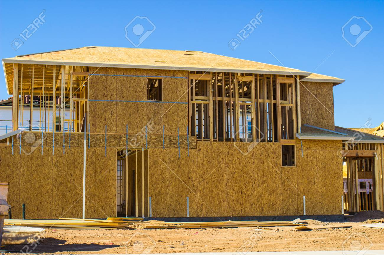 wooden framing plywood on new home under construction stock photo