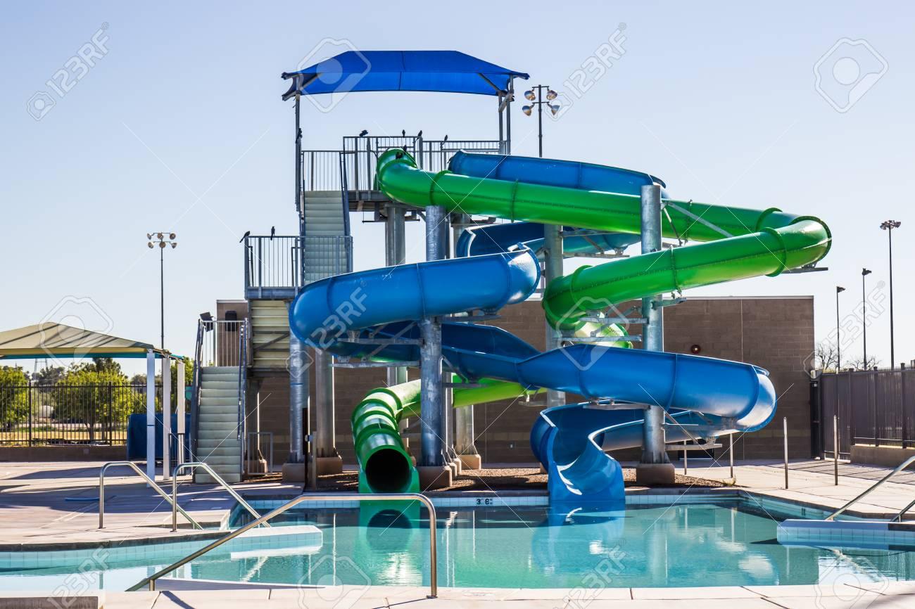 Two Tube Water Slides At Swimming Pool