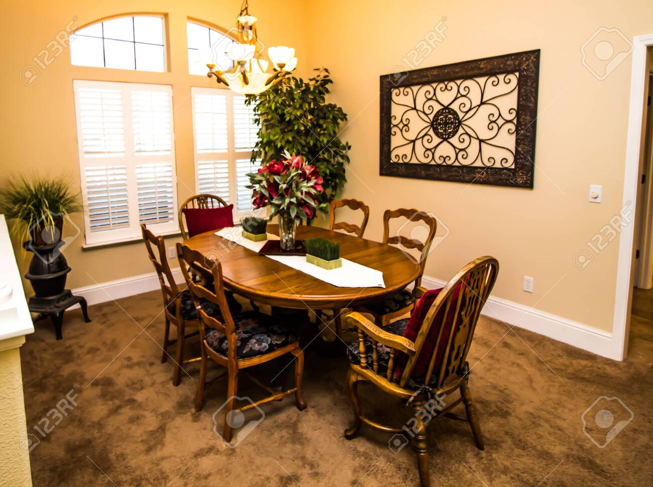 Dining Room With Wooden Table High Back Chairs Stock Photo Picture And Royalty Free Image Image 132386947