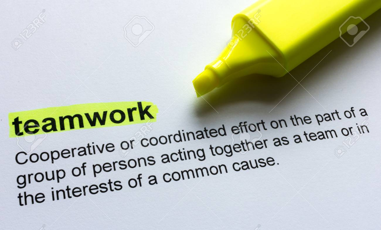 definition of teamwork, highlighted in colour stock photo, picture