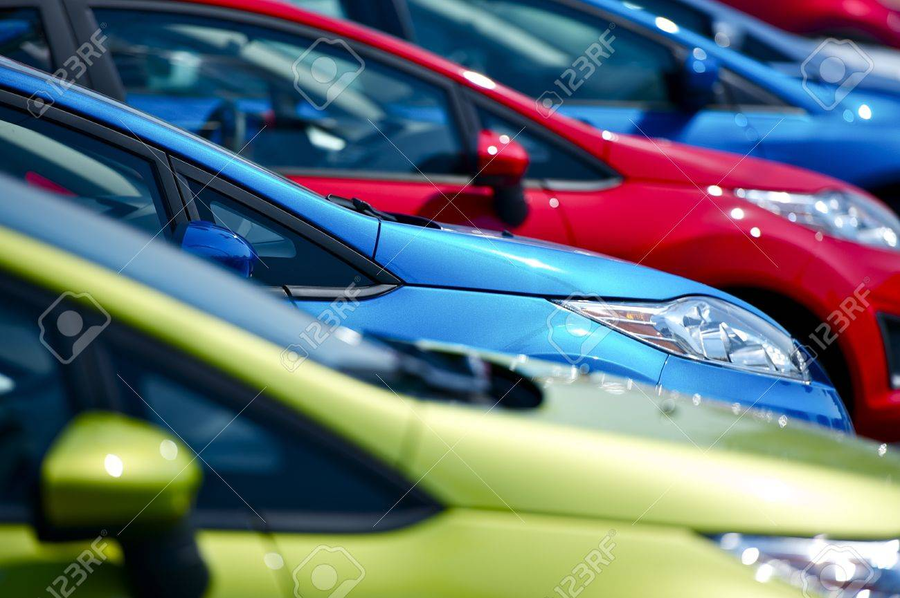 Colorful Cars Stock. Small European Vehicles in Stock. Many Colors to Choose From. Dealership Cars Stock. Transportation Photo Collection Stock Photo - 10644983