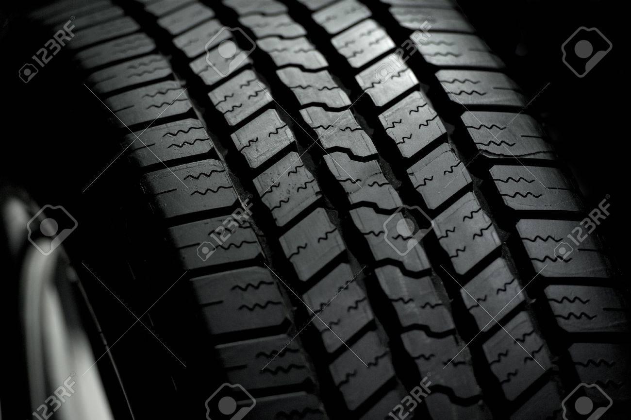 Car Tire on Black Background. Car Tire in the Dark - Spot Light Stock Photo - 12787762