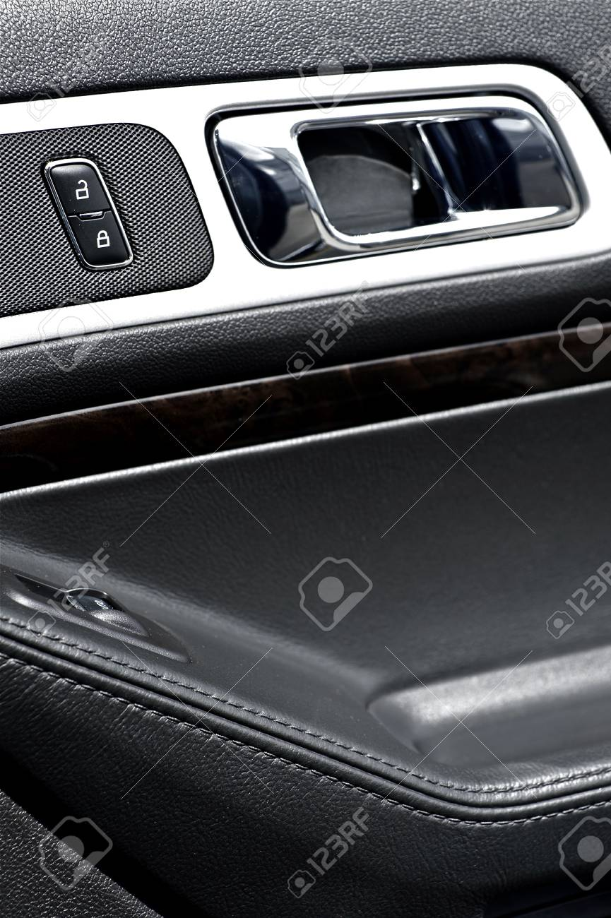 Modern Vehicle Door Inside with Black Leather and Chrome Elements  Door Handler and Lock Stock Photo - 13241628
