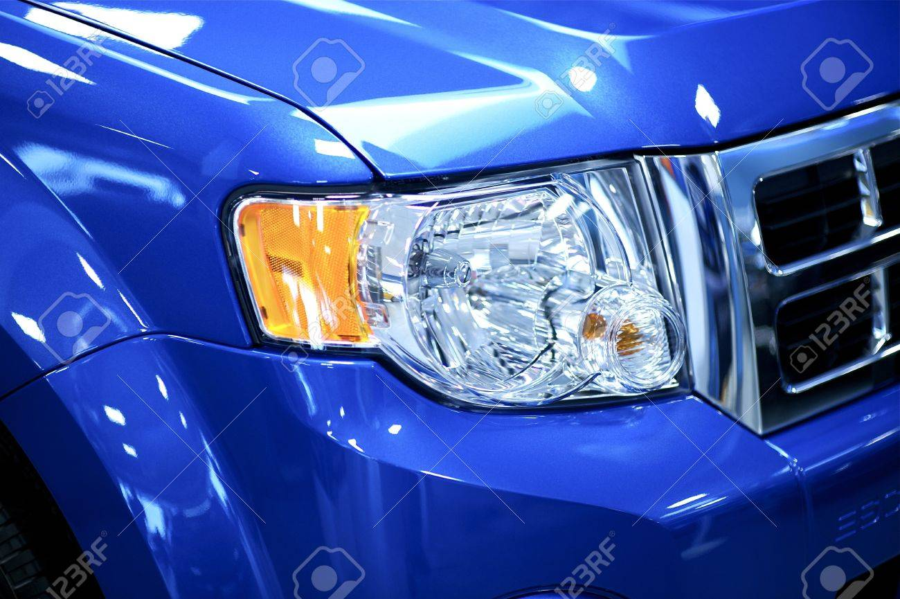 Car Headlight, Bumper and Grill  Vehicle Front End Corner  Blue SUV  Transportation Photo Collection Stock Photo - 13241869