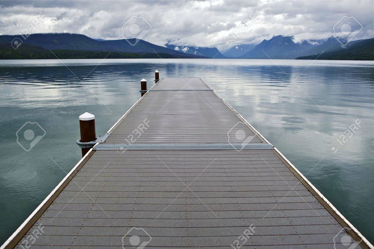 Lake McDonald Montana's Glacier National Park. Wood Floating Dock. Lake McDonald is the Largest Lake in Glacier National Park. About 16 Miles Long and a Mile Wide and Up To 470ft in Deep. Nature Photo Collection Stock Photo - 14301374