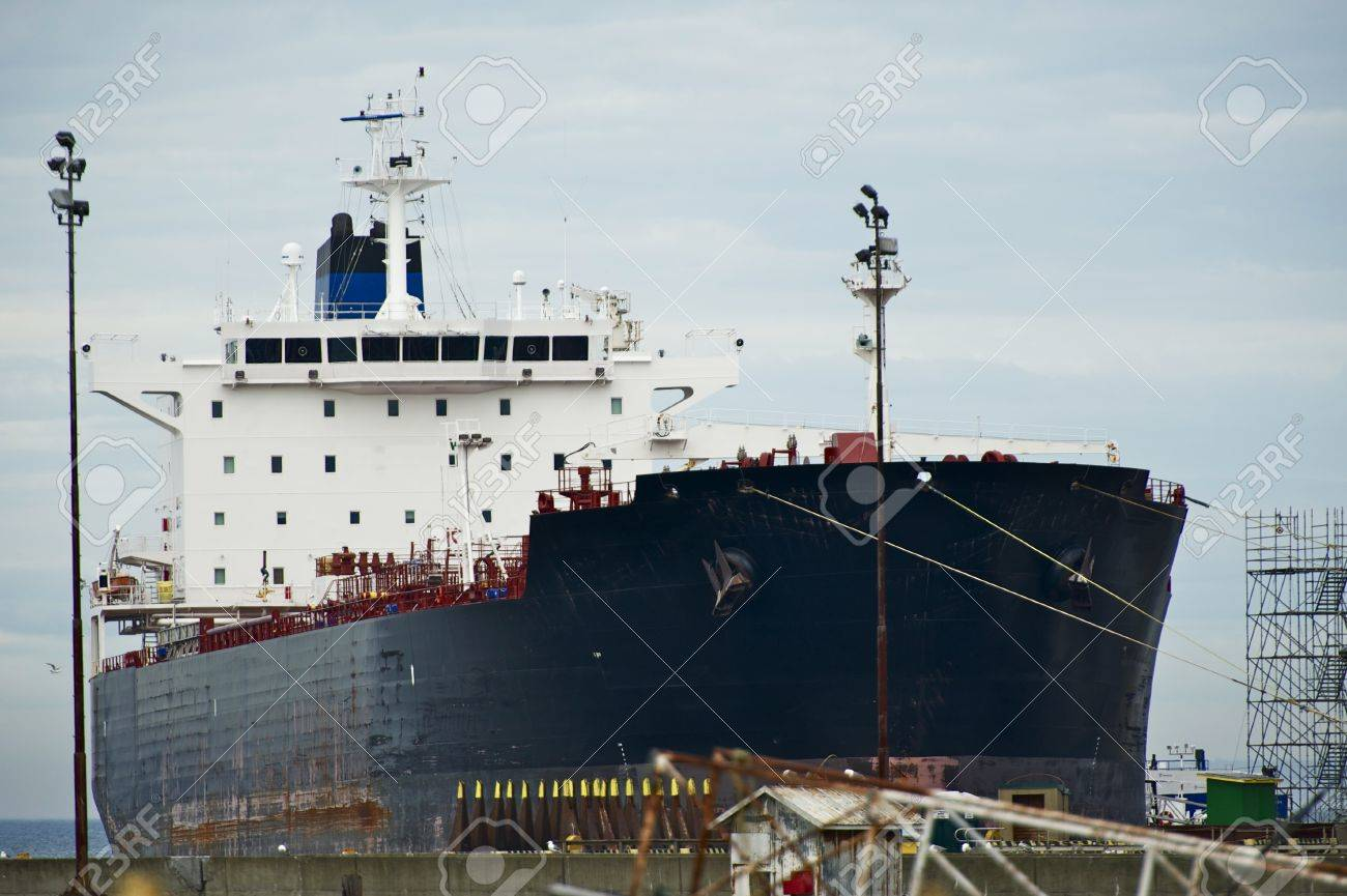 Servicing Large Commercial Container Ship - Transportation Photo Collection. Stock Photo - 14699862