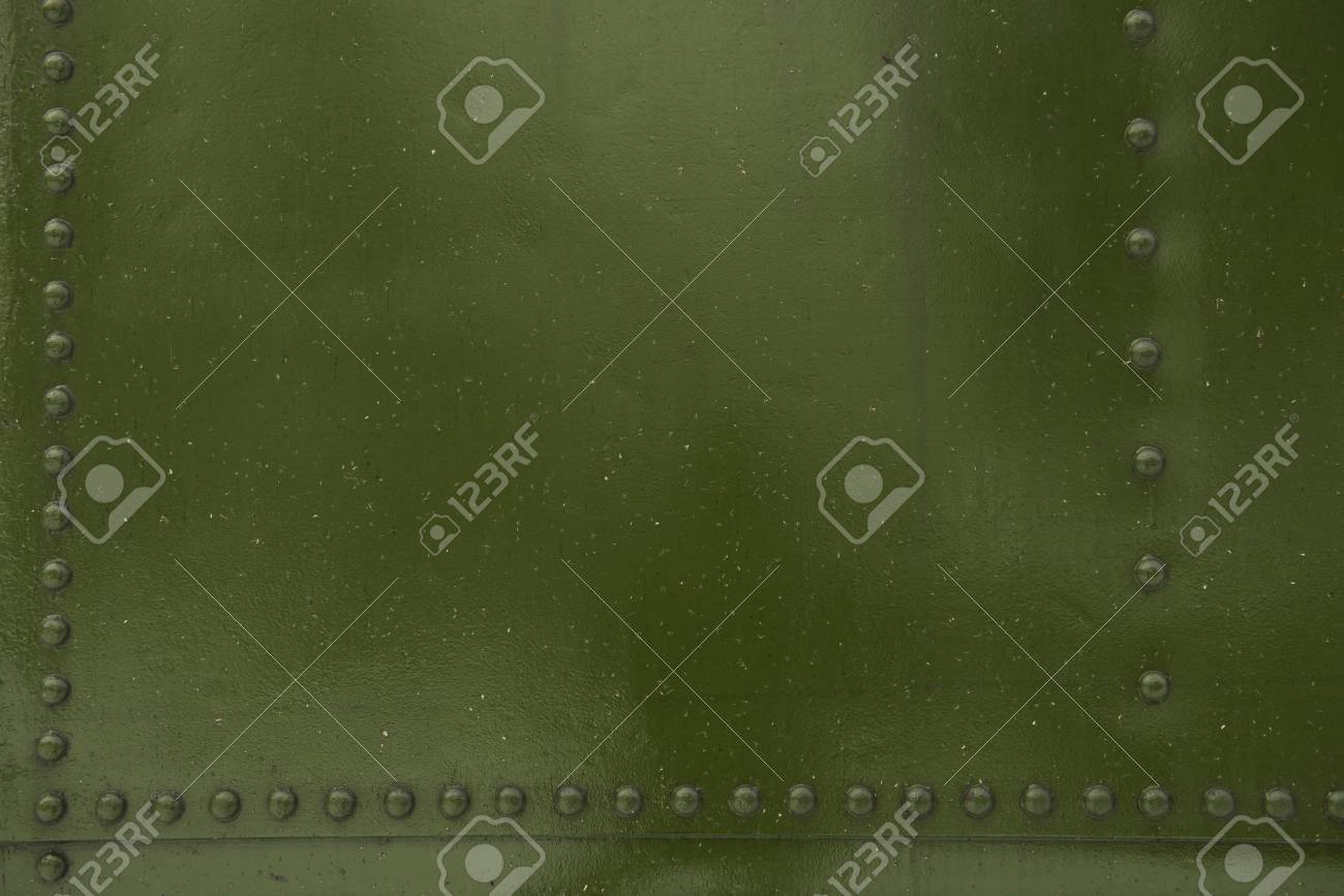 Green Metal with Bolt Heads Photo Background. Stock Photo - 17880439