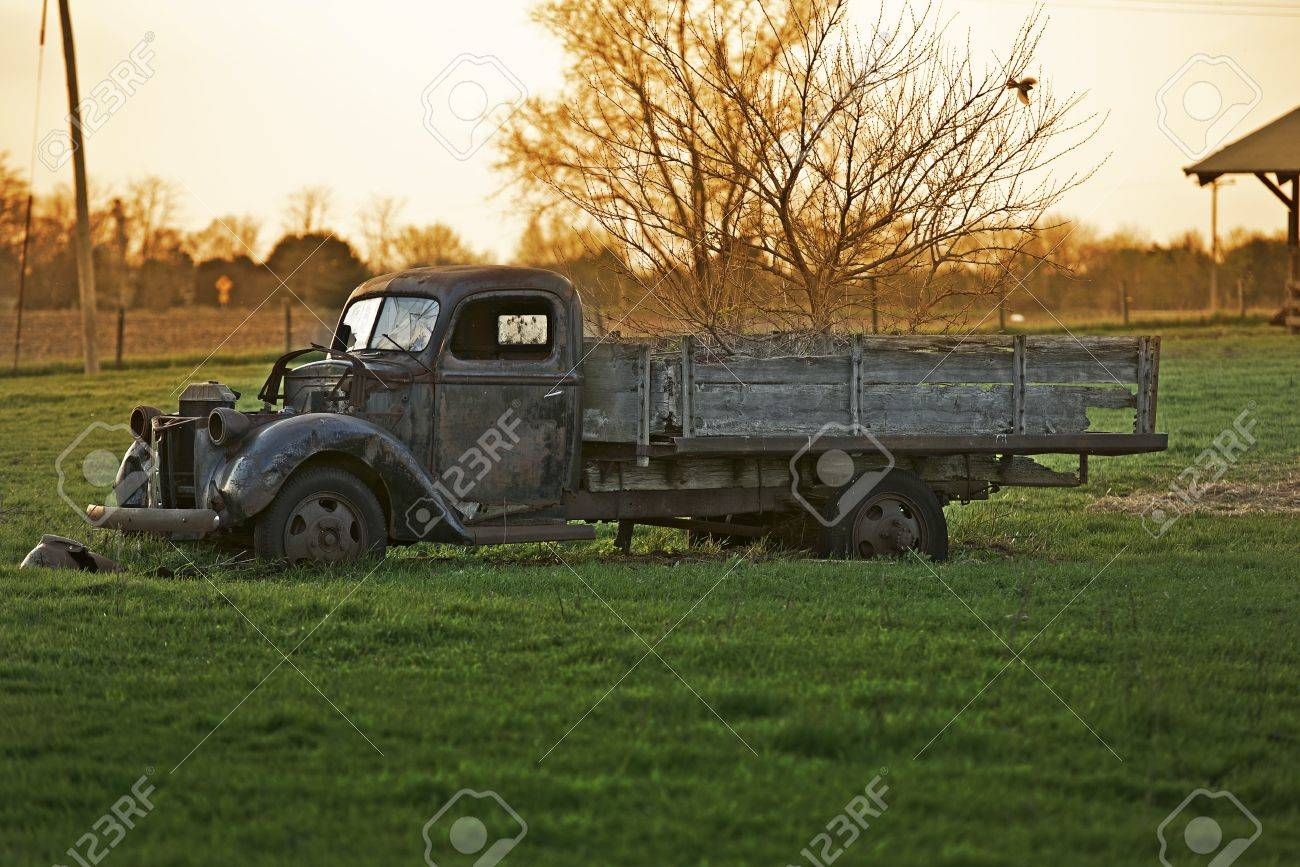 Rustic Old Pickup Truck on the Backyard. Abandoned Old Truck. History of Transportation. American Backyard Photo Collection. Stock Photo - 19642374
