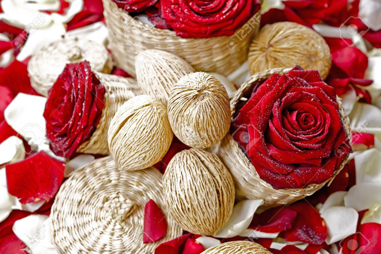red roses floral decoration rose buds coconuts and small wattle