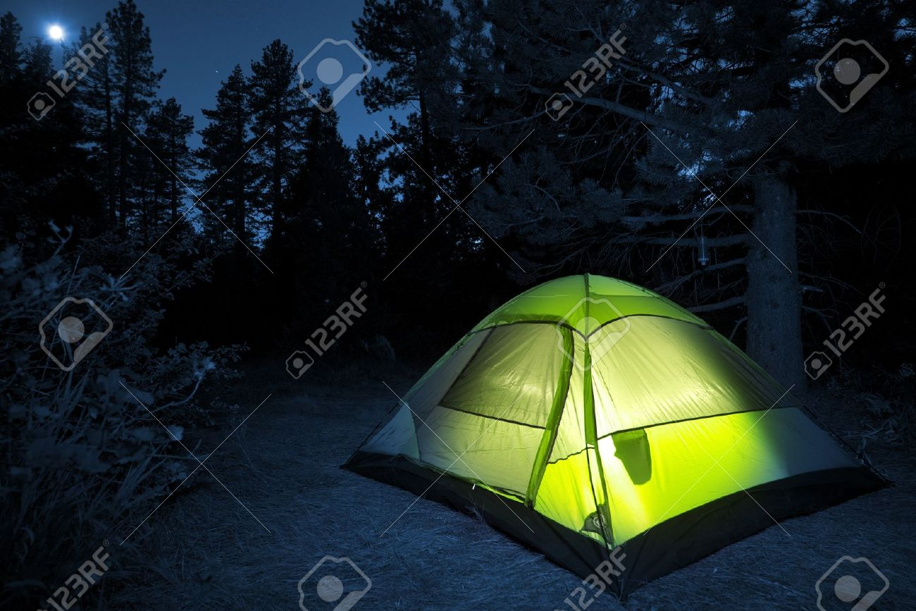 Small Camping Tent Illuminated Inside Night Hours Campsite Recreation And Outdoor Photo Collection