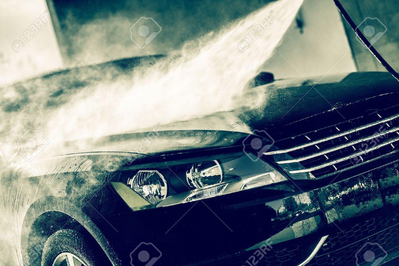 washing car car wash closeup washing modern car by high pressure water