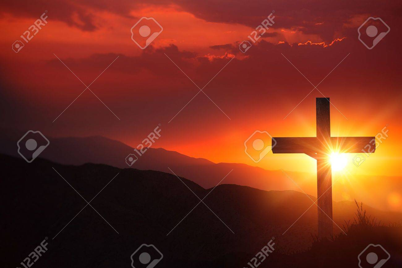 The Light of Christ Old Wooden Crucifix on the Desert During Scenic Sunset. - 54031618