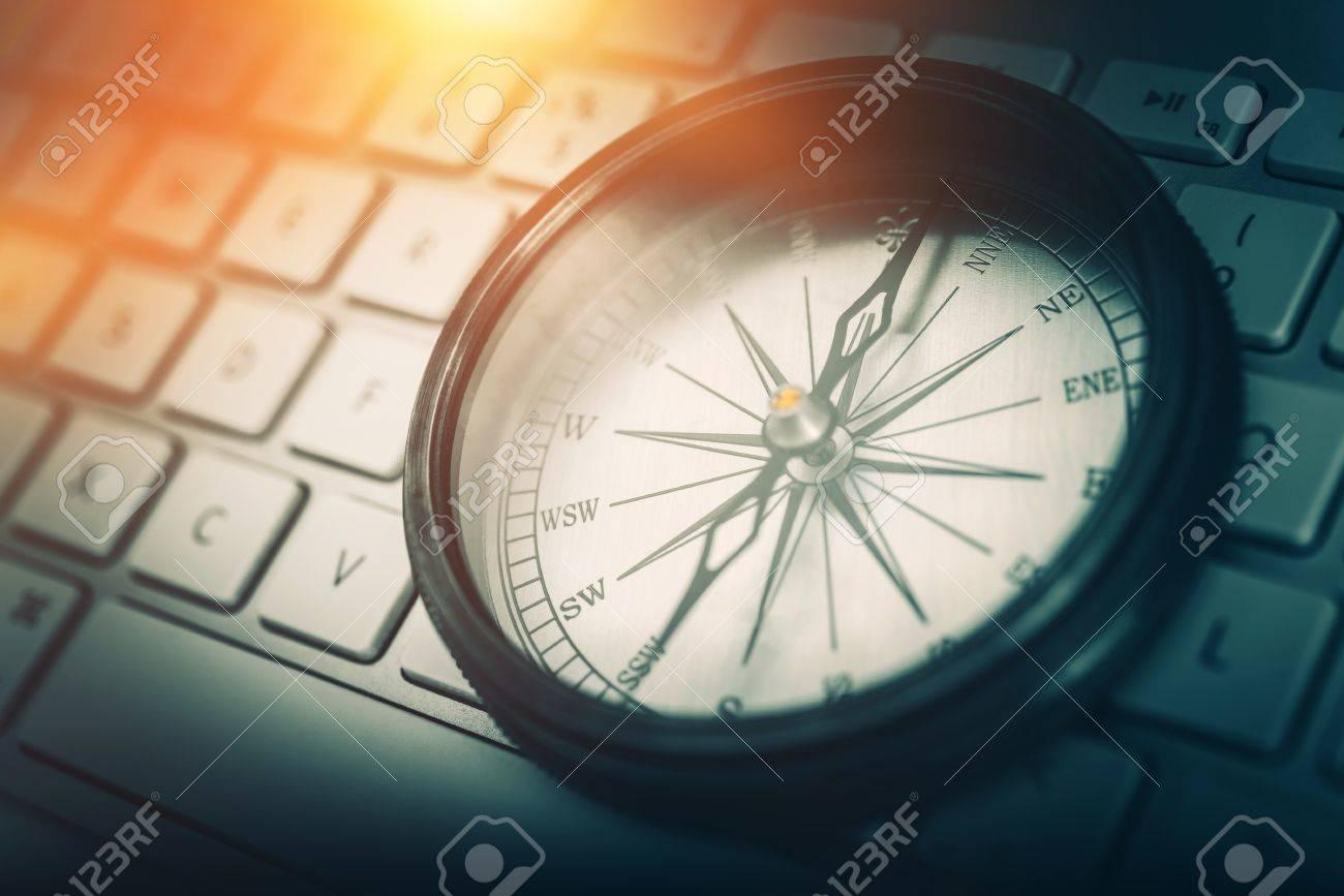 The Internet Navigator Concept Photo. Vintage Metallic Compass on the Computer Keyboard. Navigation Through the Internet. - 56892326