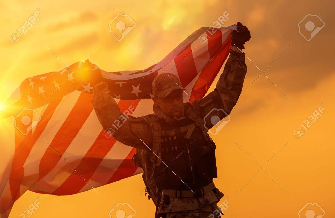 Soldier Celebrating Victory Running with Large American Flag. Trooper with the Flag. - 58950898