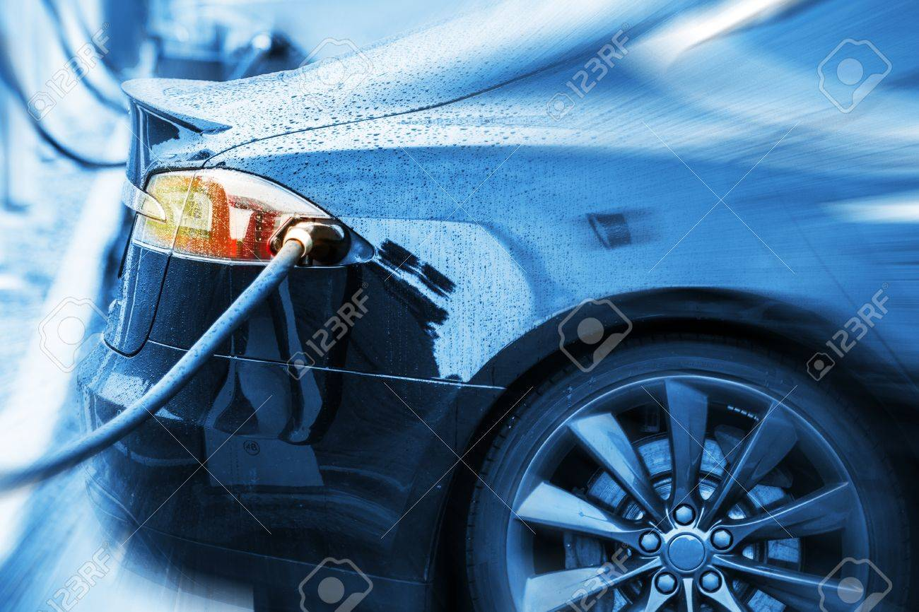 Zero Emission Electric Car in Charging Station. Modern Electric Sedan Car Concept Photo. - 62488392