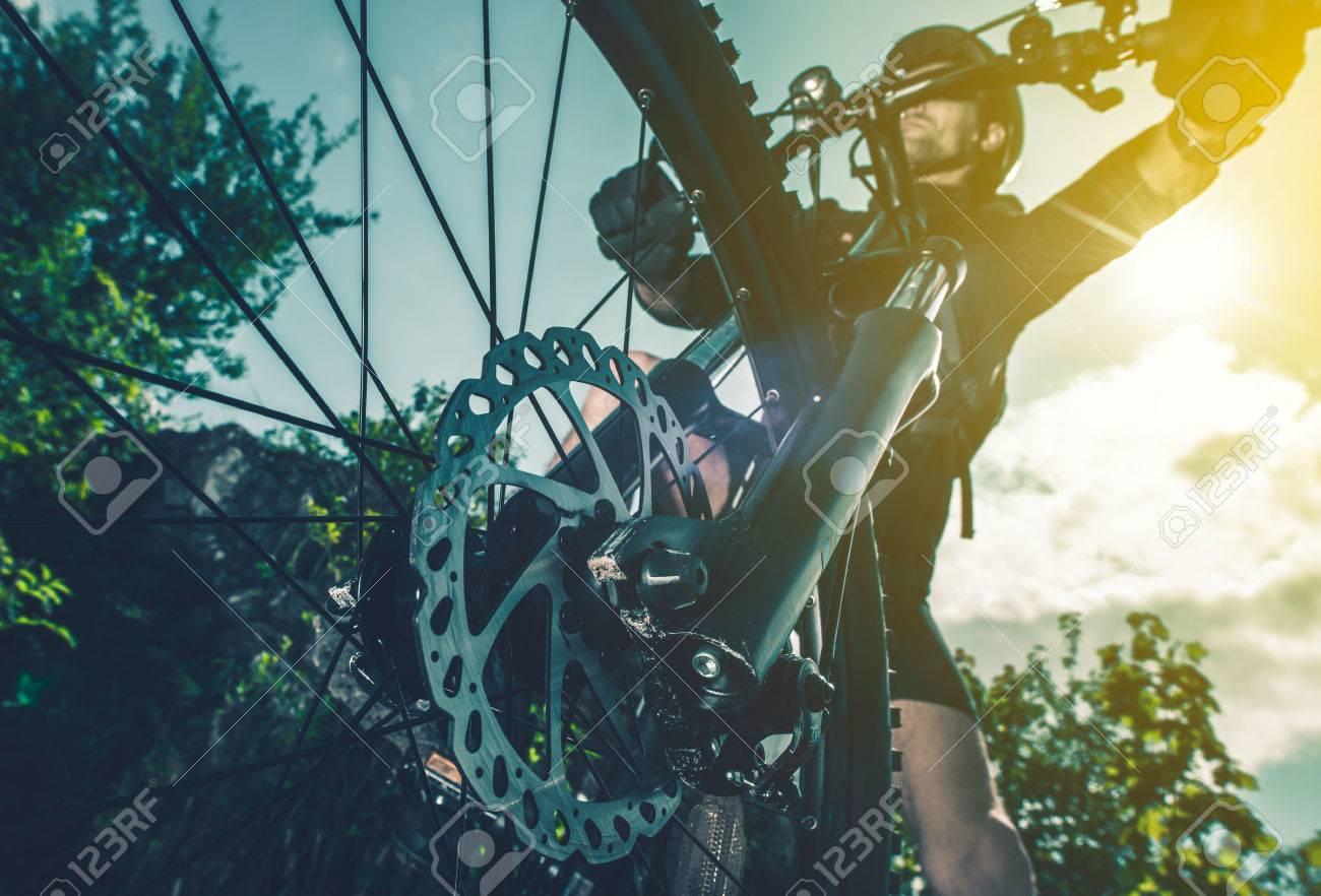 Extreme Biking Concept  Bike Front Wheel Brakes Closeup Perspective