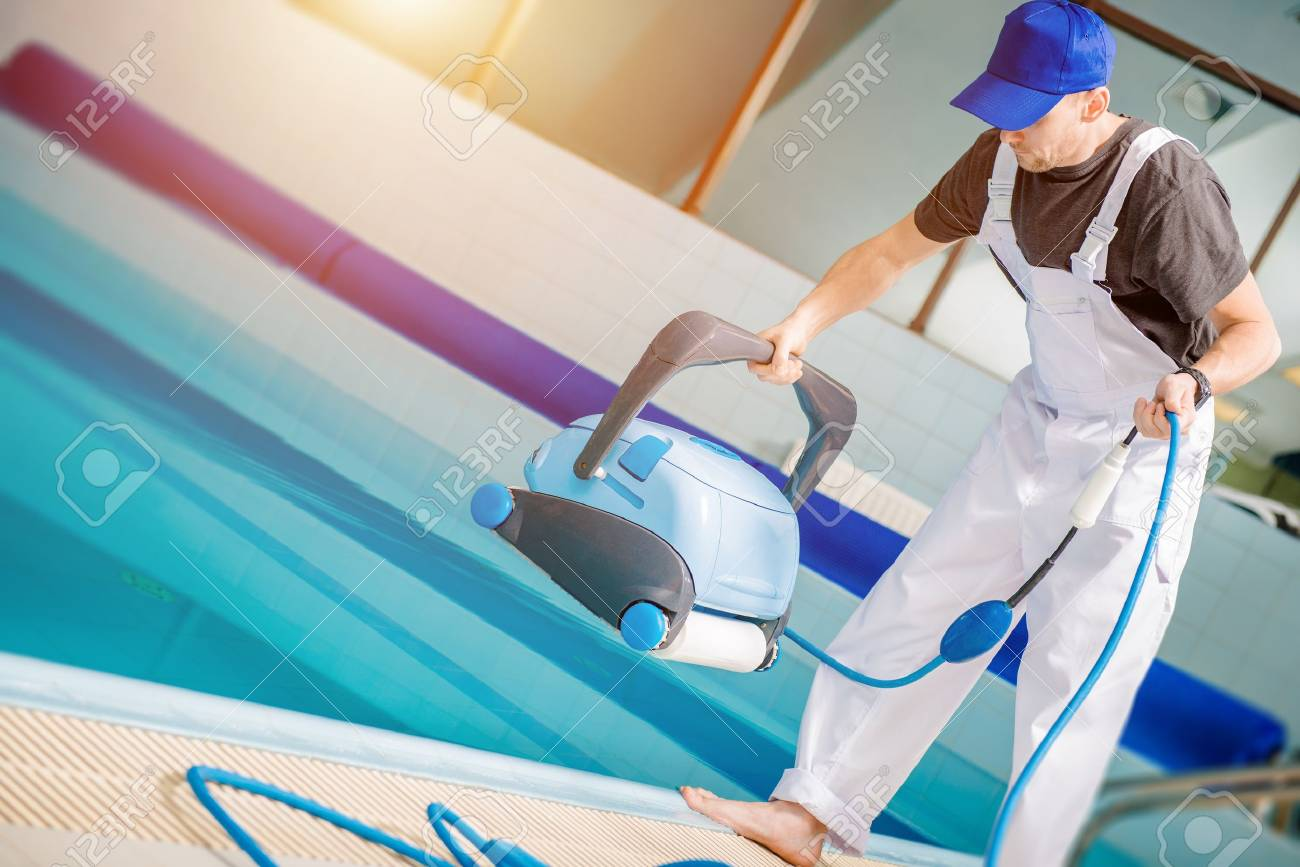 Swimming Pools Technician With Pool Cleaning Robot Preparing.. Stock ...