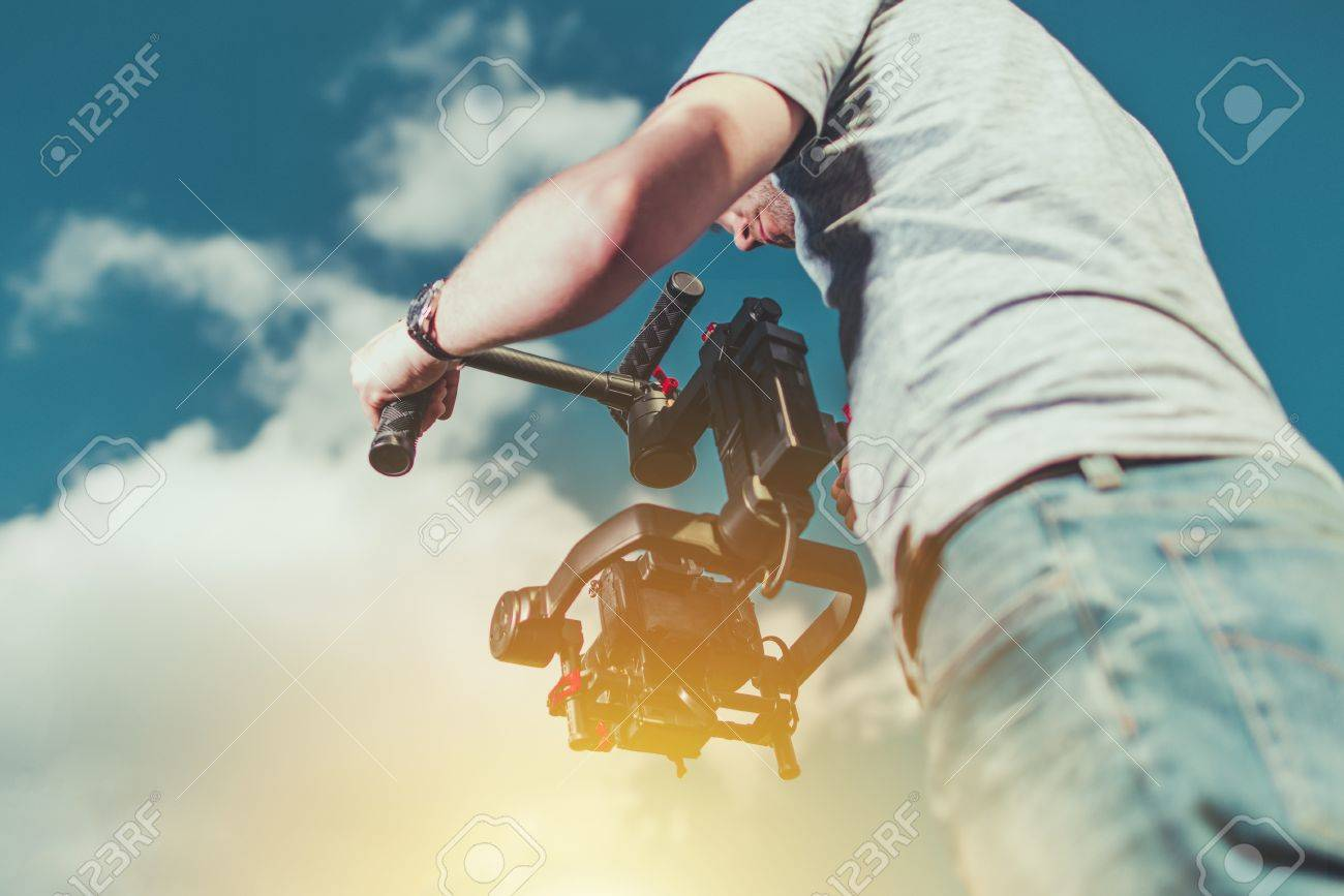Stock Photo   Taking Video Shoots Using DSLR Digital Camera Installed On  The Pro Gimbal. Motion Picture Equipment And Work.