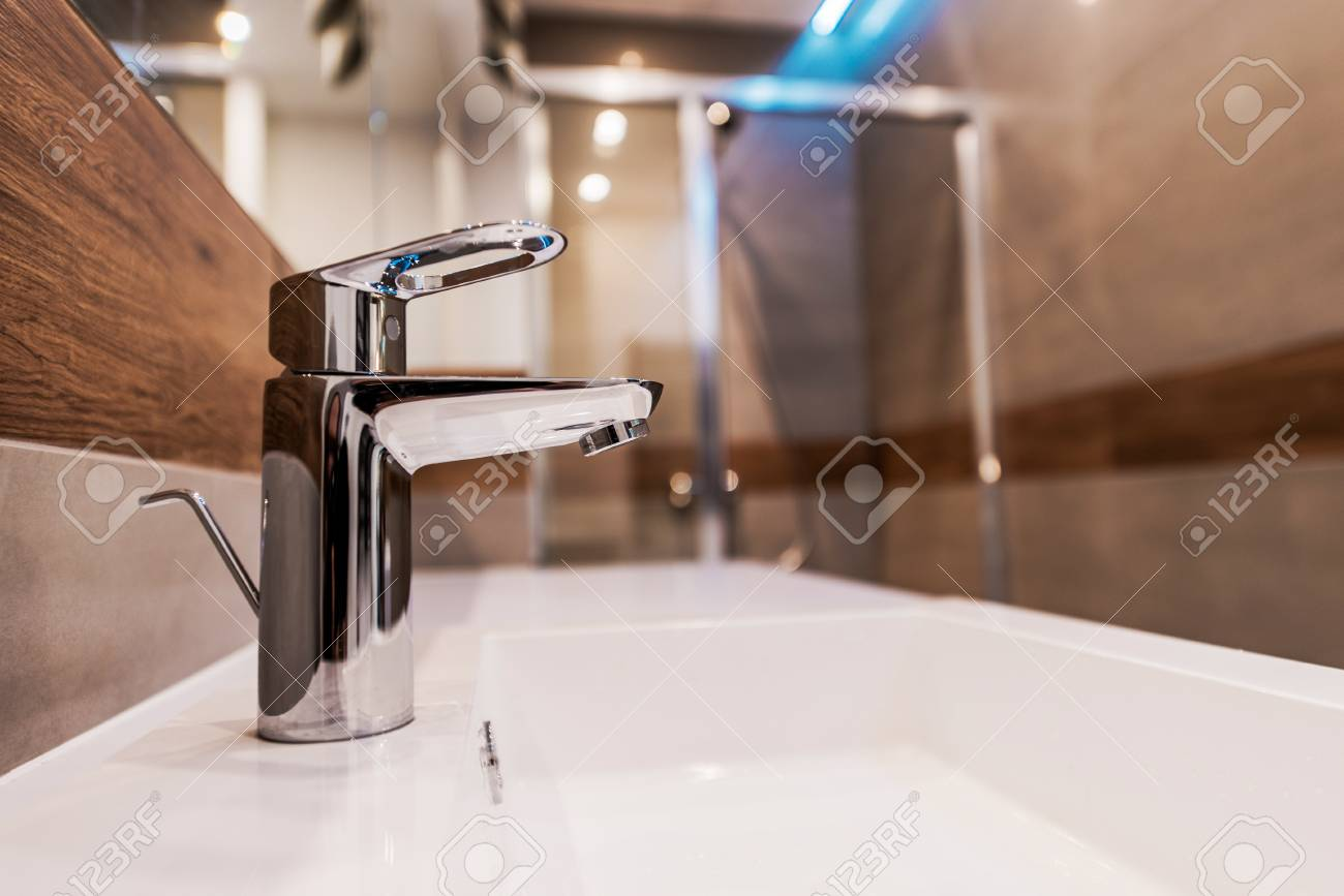Modern Bathroom Sink Faucet Closeup Photo. Stock Photo   83733558