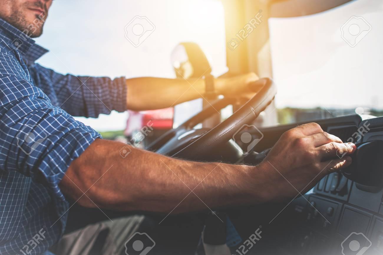 Semi Truck Driver Job. Caucasian Trucker Preparing For Long Haul Shipping. - 92682883