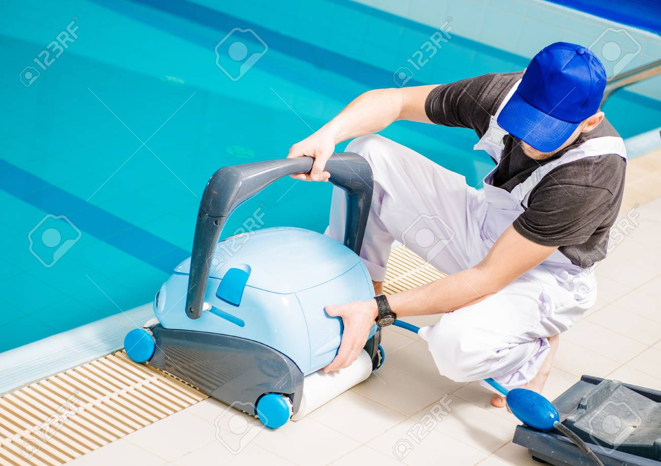 Pool Vacuum Cleaner. Caucasian Swimming Pools Technician With ...