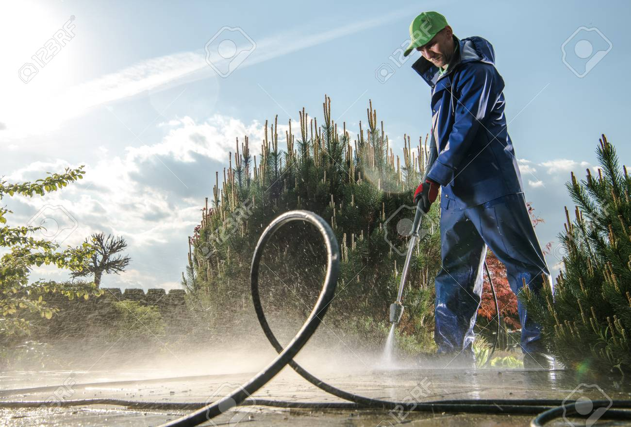 Garden Washing Maintenance. Caucasian Worker in His 30s with Pressure Washer Cleaning Brick Paths. - 122097833