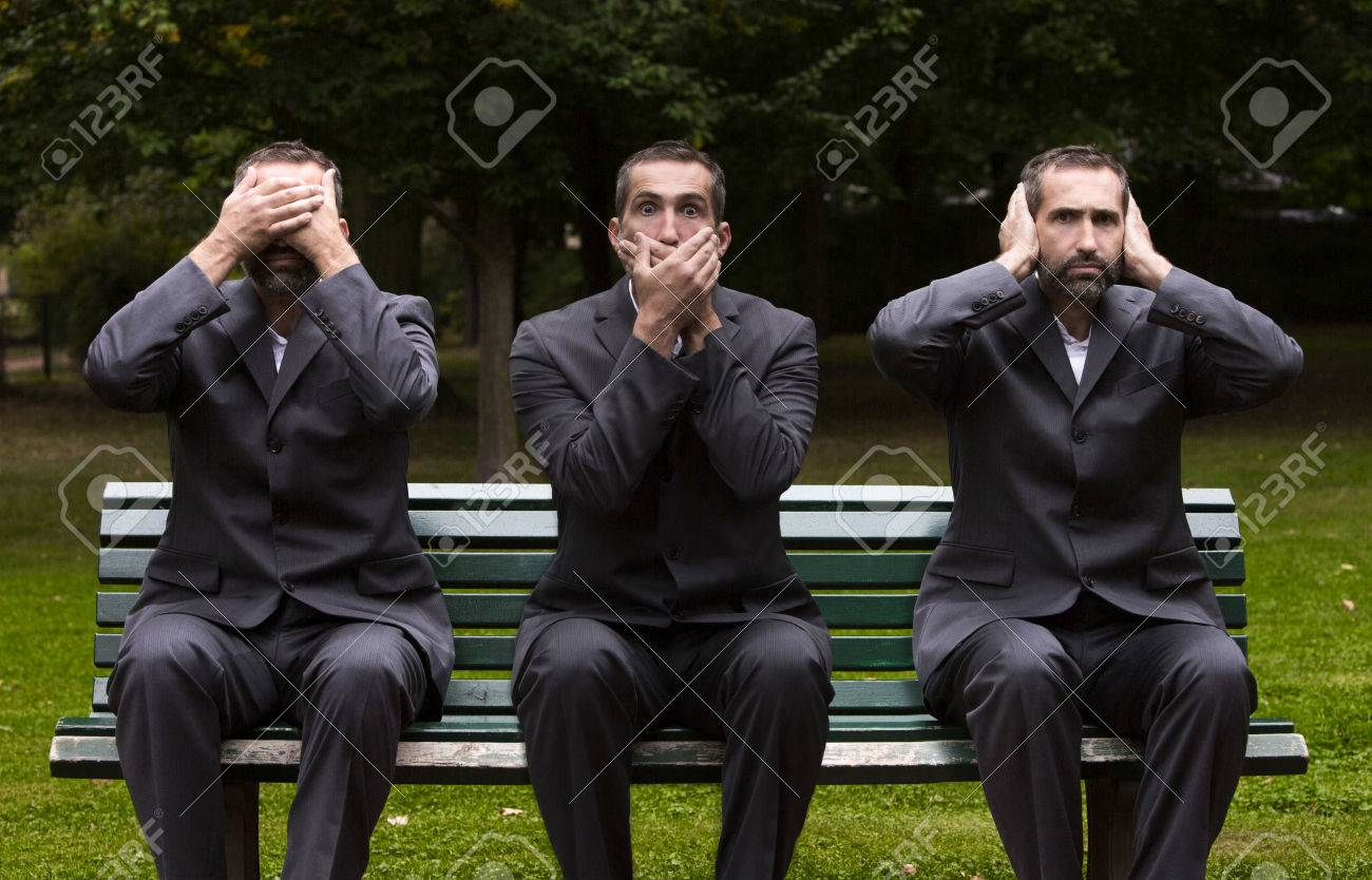 businessman sitting on a bench three times covering his ears,eyes and mouth - 31775270
