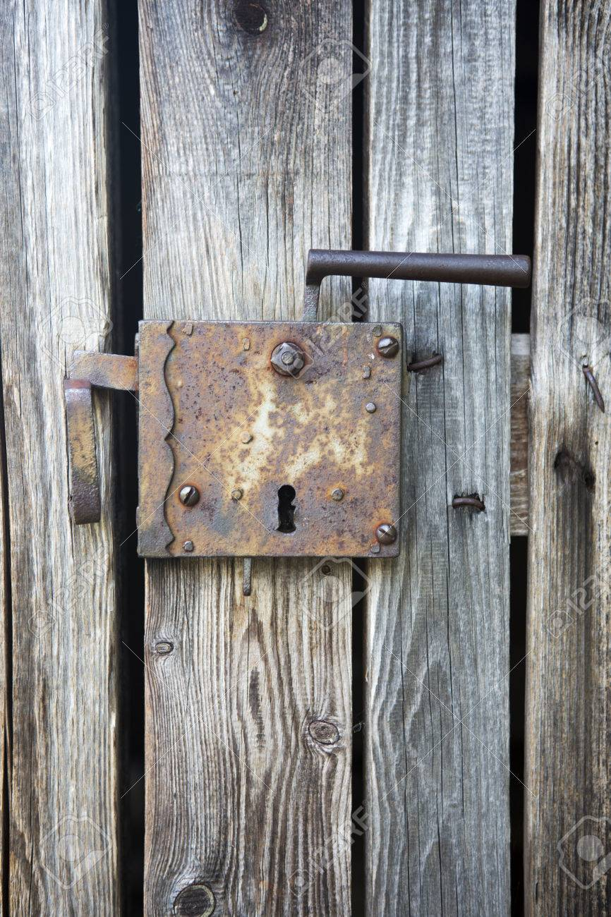 old rustic wooden entrance door with antique door handle Stock Photo -  42039684 - Old Rustic Wooden Entrance Door With Antique Door Handle Stock Photo