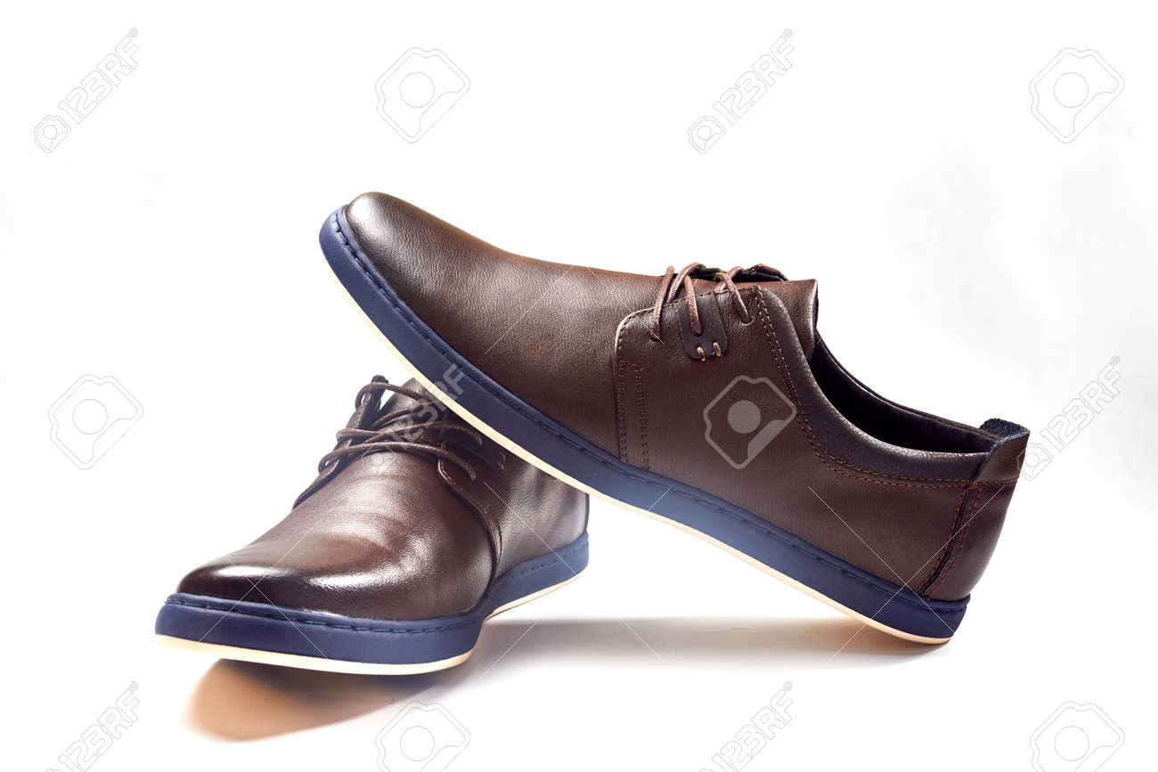 Men fashion brown shoe leather over white background. Pair casual stylish footwear. Close up - 146118301