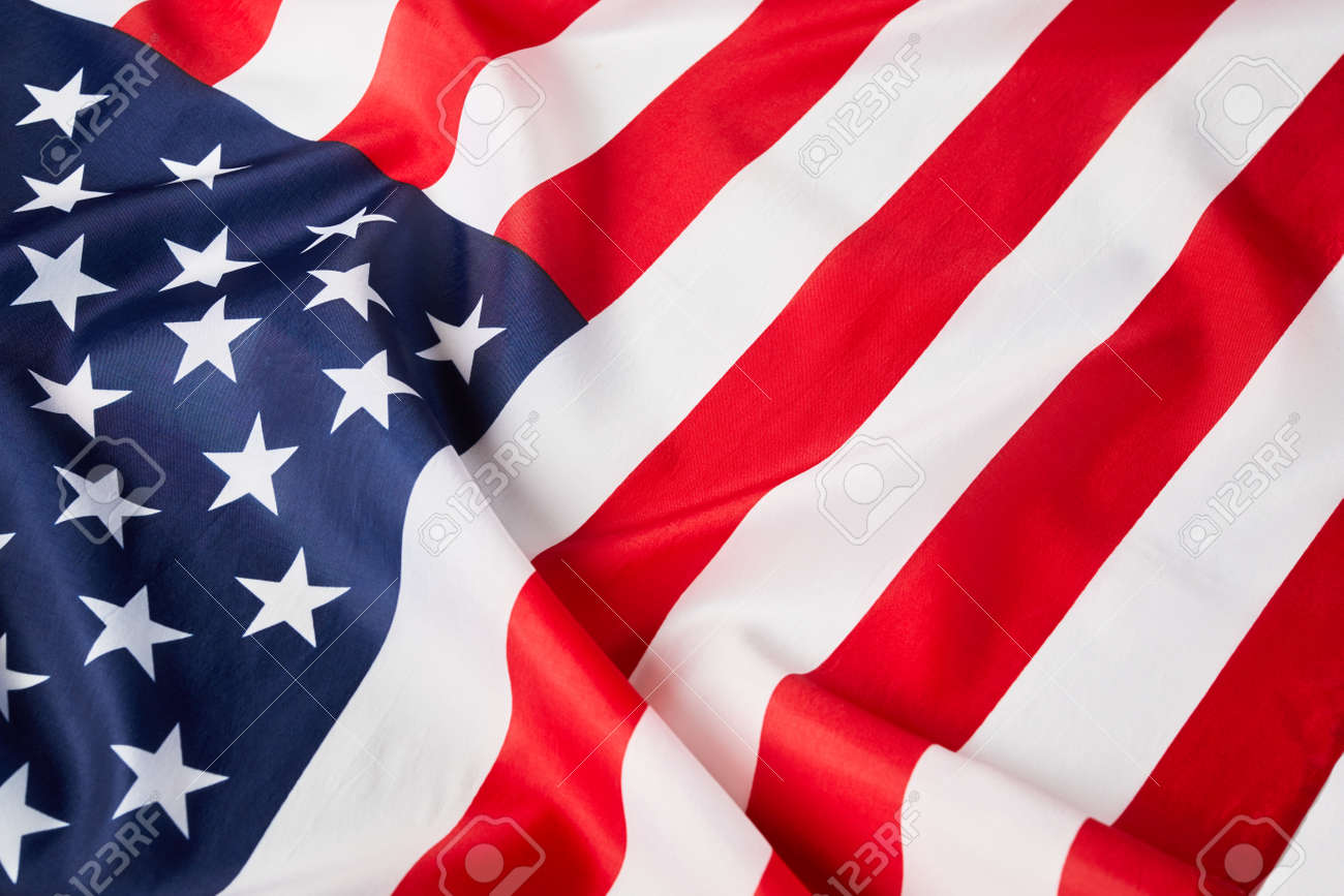 Close up of ruffled American flag. Satin texture curved flag of USA. Memorial Day or 4th of July. Banner - 159068558