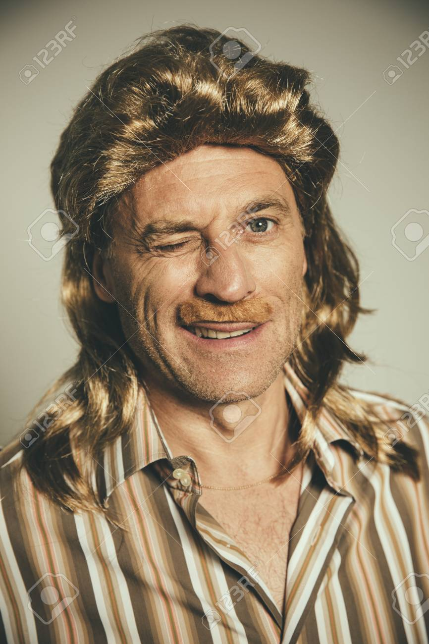 Portrait of winking man with wig and fake moustache Stock Photo - 86827154 0f4d90efd