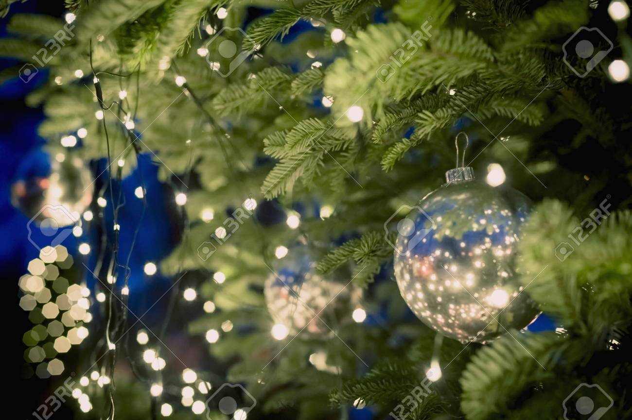 christmas tree with baubles and fairy lights stock photo 90895458
