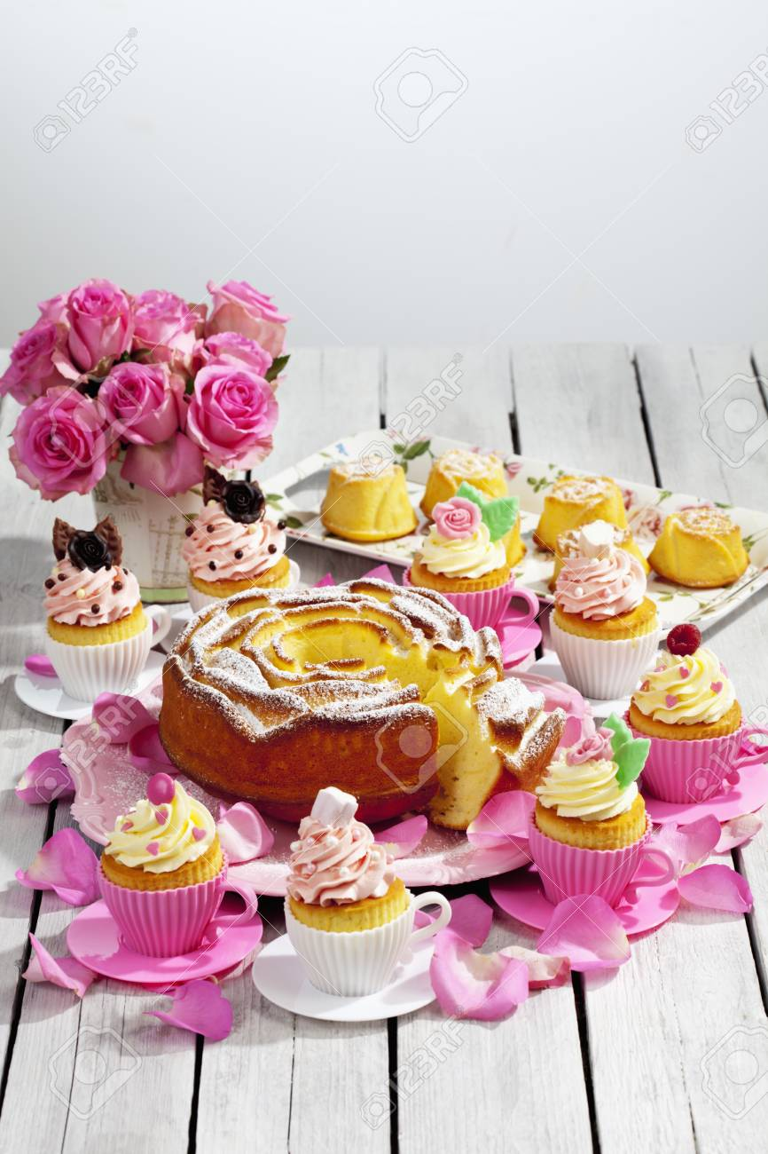 Birthday Cake Cupcakes Muffins And Flower Vase Of Pink Roses On Wooden Table Stock