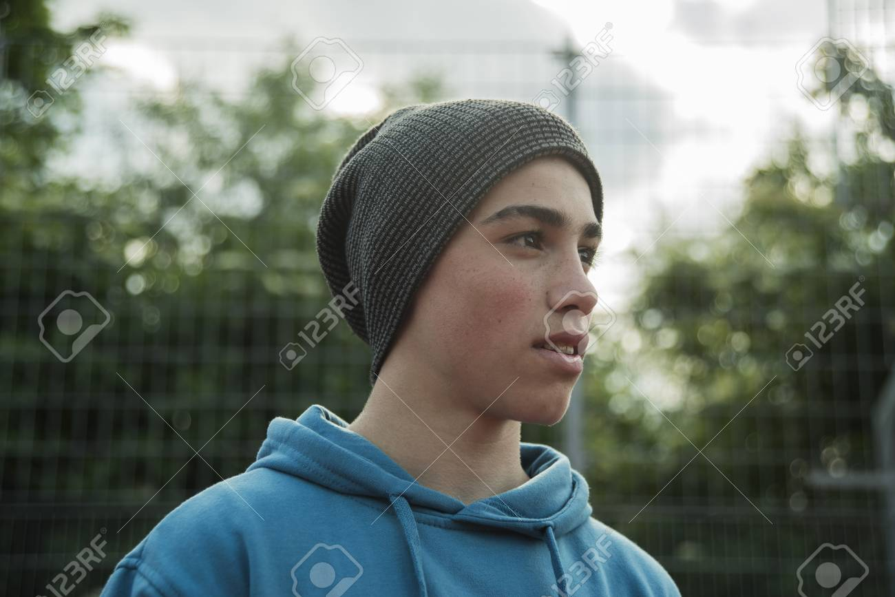 Serious boy wearing beanie outdoors Stock Photo - 91918271 fabca40dce3