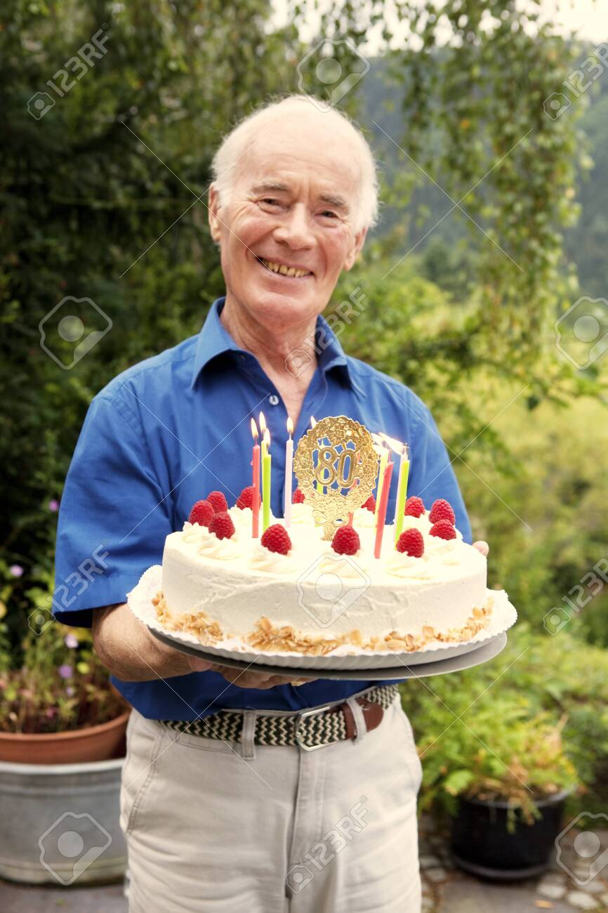 Pleasing Senior Man Holding 80Th Birthday Cake Stock Photo Picture And Birthday Cards Printable Inklcafe Filternl