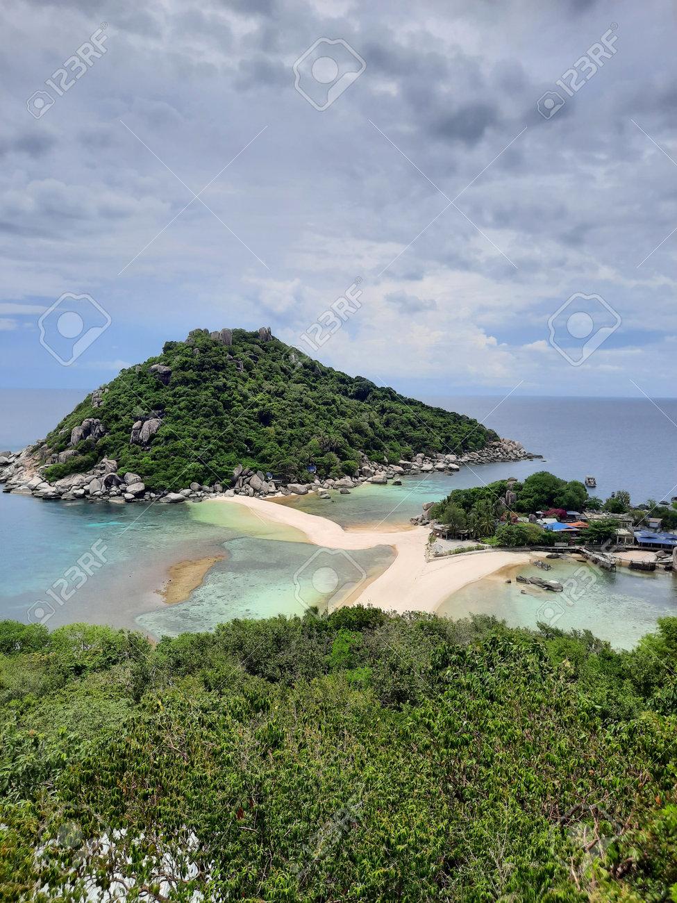 at the most famous viewpoint named Koh Nang Yuan Viewpoint on the tropical small island named Nangyuan Island Beach in Thailand next to the island named Koh Tao at midday, May 3, 2021 - 169664545
