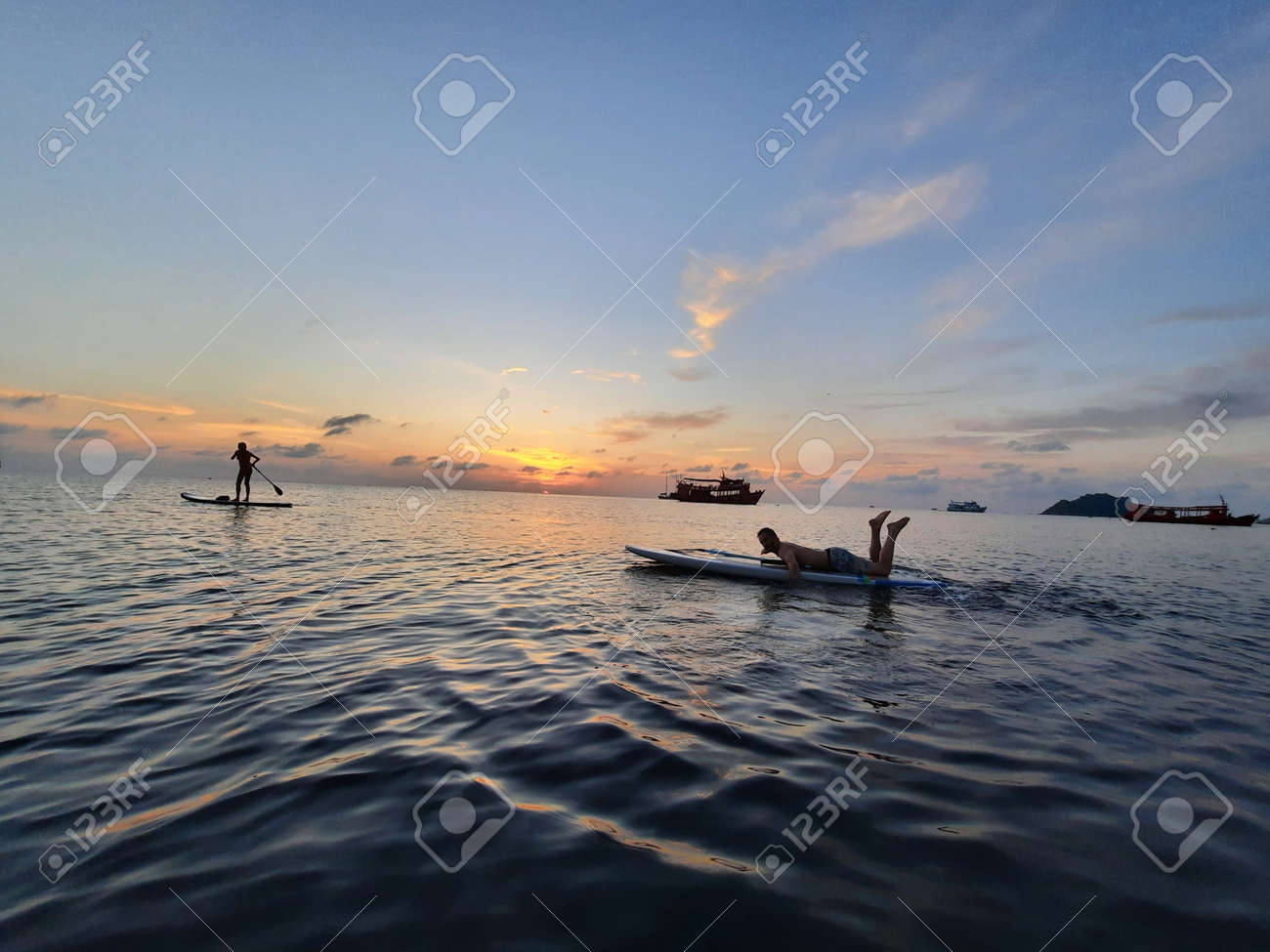 on a stand up paddle board, young man 34 years old, German, lies on a board on the ocean in Thailand, on the island Koh Tao at sunset - 169664548