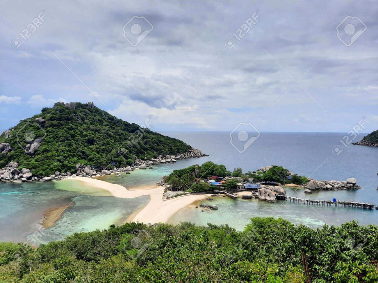 at the most famous viewpoint named Koh Nang Yuan Viewpoint on the tropical small island named Nangyuan Island Beach in Thailand next to the island named Koh Tao at midday, May 3, 2021 - 169664550
