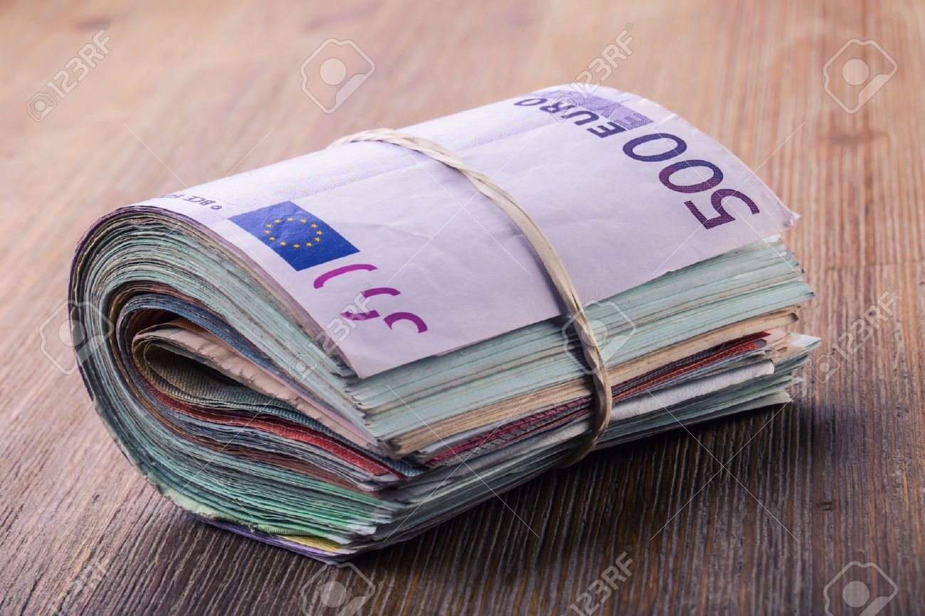 Euro banknotes. Euro currency. Euro money. Close-up Of A Rolled Euro