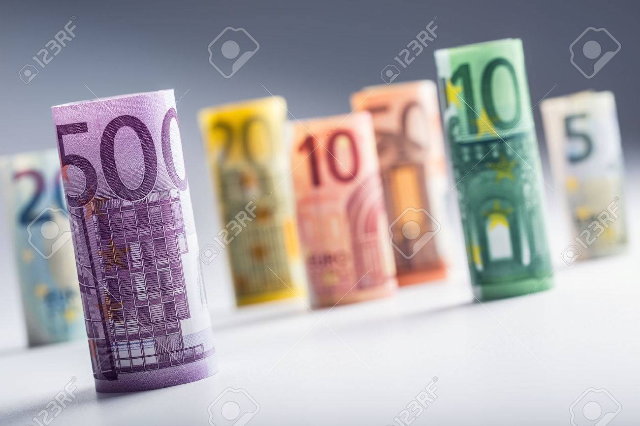 Several hundred euro banknotes stacked by value. Euro money concept. Rolls Euro banknotes. Euro currency. Announced cancellation of five hundred euro banknotes. Banknotes stacked on each other in different positions. Toned photo. - 52004283